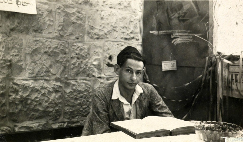Gershom Scholem sitting in Sukka learning Zohar See page for author / Public domain